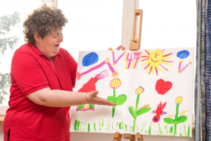 disabled woman showing her drawing